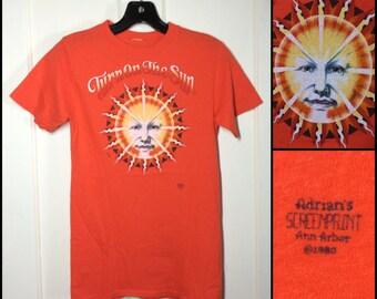 1980s Orange Turn on the Sun Face T-shirt looks size XS 15x24.5 all cotton by Adrians Screenprint Ann Arbor single stitch