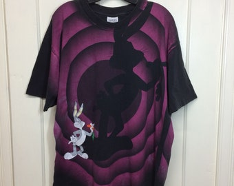 1990s 1992 Looney Tunes Bugs Bunny character all over print t-shirt size XL 23x27 faded black oversized fit single stitch made in USA