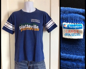 1970s University of Wisconsin blue bar cotton Champion brand t-shirt size large looks medium 19x24  Platteville striped sleeves made in USA