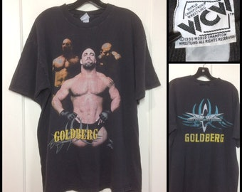 1990s 1998 WCW Goldberg World Championship Wrestling t-shirt looks size XL 23x28 faded black cotton