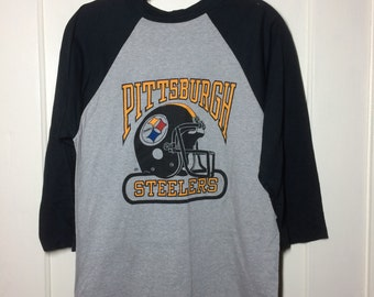 1970s Pittsburgh Steelers Football Team NFL Sports baseball style t-shirt size Medium 18x26 3/4 length sleeves Black Heather Gray Logo 7