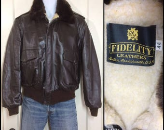 1970's brown leather bomber flight jacket with fleece lining faux fur collar size 44 large barely used condition made in USA