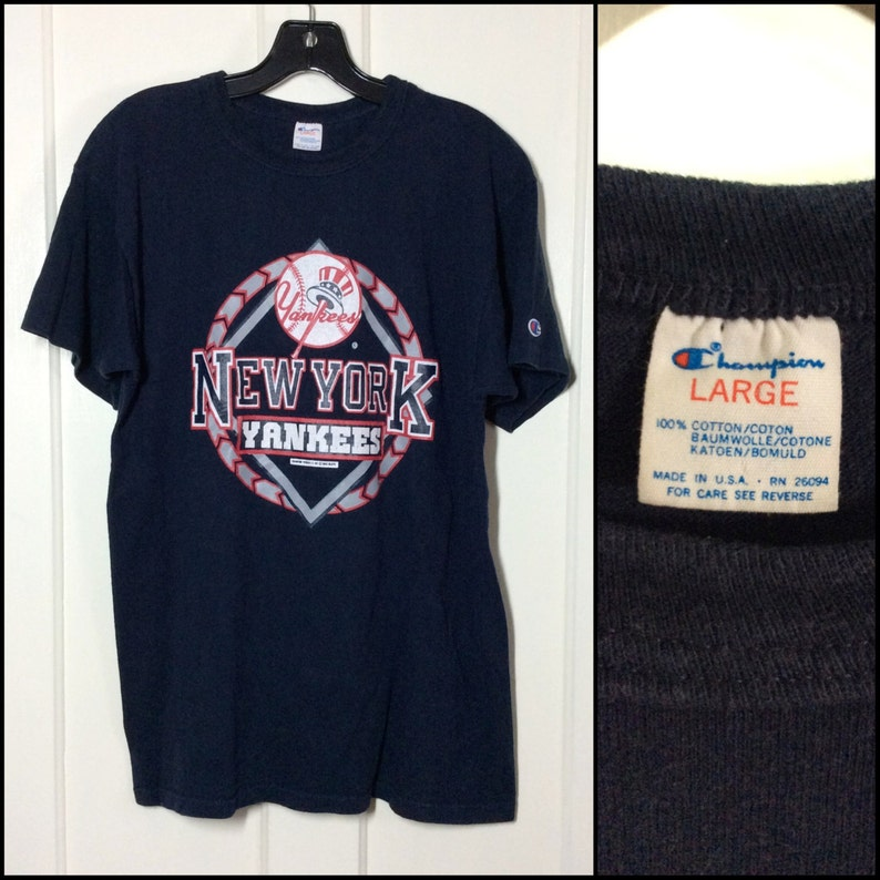db4f366f36c42 Vintage NY Yankees baseball team NYC 1980s Champion Brand thick cotton  T-shirt size Large 20x27 navy blue single stitch made in USA