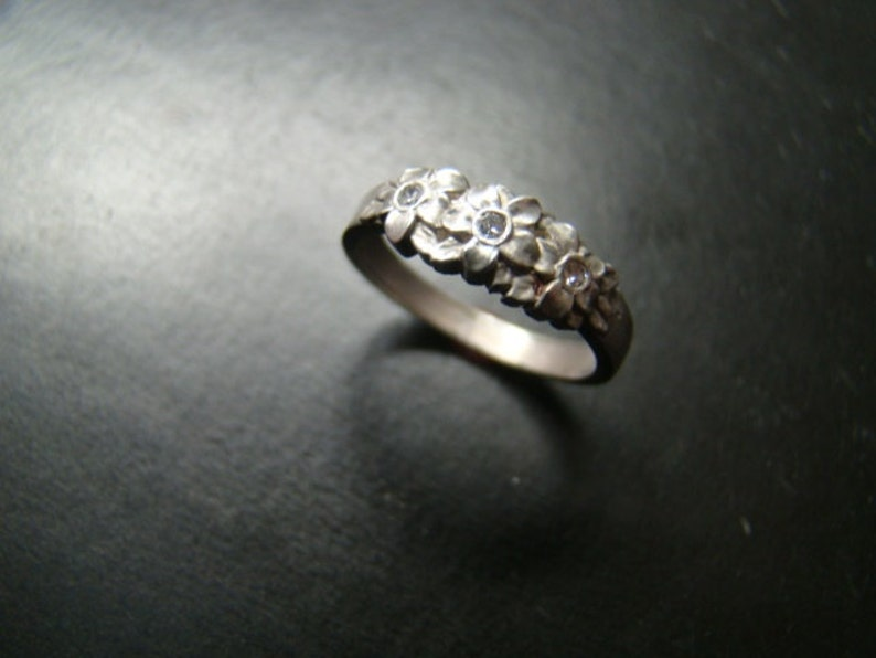 Adorable Sterling Silver flower band with genuine diamonds