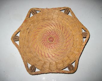 Antique straw basket with nuts woven in