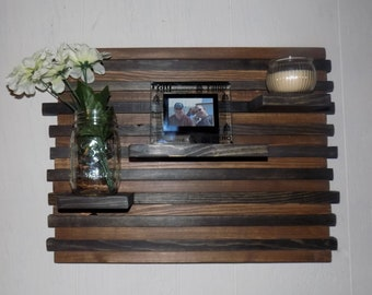 wooden functional art piece with shelves