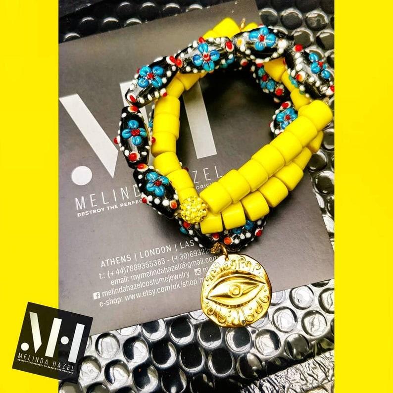 Triple devil eye pendant by Melinda Hazel Yellow Bracelet,Dark deads floral Design