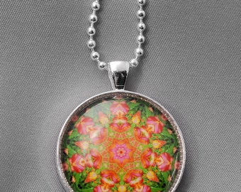 "A fun, fractal photo mounted under a glass cabochon in a round silver pendant and hung on an 18"" silver ball chain."