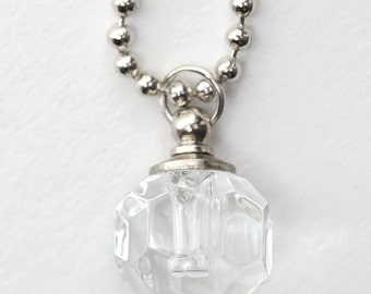 A sweet little glass perfume bottle necklace that can be filled with a smidge of your favorite fragrance