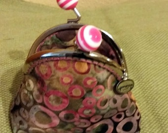 Coin purse with bubble gum metal framed push closure, 100% cotton in shads of purples, pink, aqua, black, charm attached