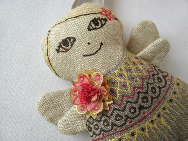 linen ornament decorated with silk flower ***Item on sale*** Previous price Fair-haired linen angel with pink gold flowers 28.50 EUR