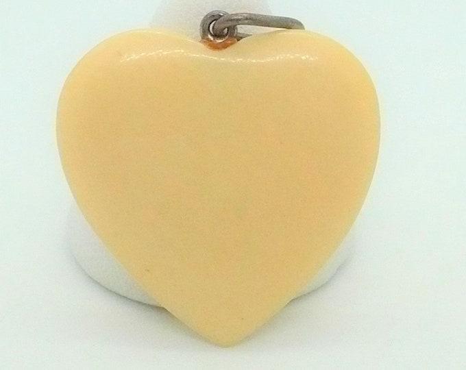 Vintage Celluloid Heart Pendant