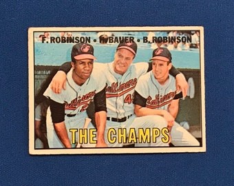 1967 Topps  #1 The Champs Baltimore Orioles Frank Robinson  Hank Bauer Brooks Robinson Baseball Card Trading Card