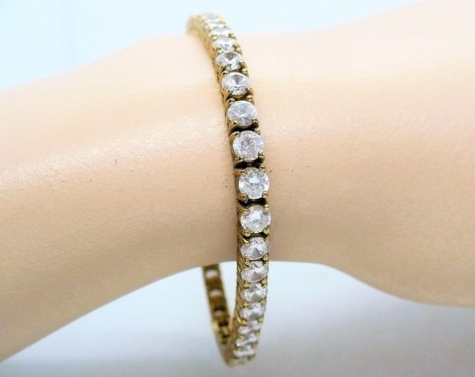 """4mm Lab-Created White Sapphire Tennis Bracelet in Sterling Silver with Yellow Gold - 7"""""""