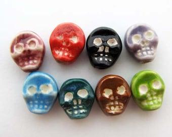 4 Tiny Skull Beads - flat white eyes multi colored - CB673