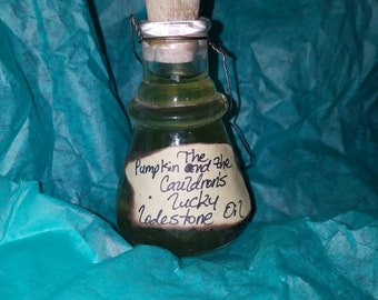 Lucky lodestone oil in 3 oz glass corked bottle