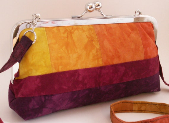 Handmade patchwork clutch shoulderbag handbag. Hand dyed cotton. Purple, red, orange, yellow. Patchwork Sunrise by Lella Rae on Etsy