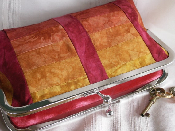 Handmade, hand dyed, patchwork clutch handbag. Red, orange, gold, yellow. SUNRISE by Lella Rae