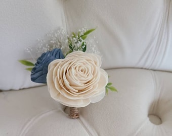 Sola wood boutonniere,  ivory and slate blue flowers,  wedding flowers