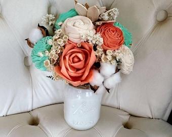 Beach sola flower arrangement,  mint and coral flowers,  wooden flower centerpiece