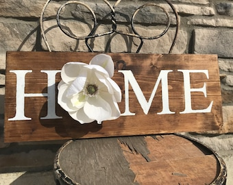 Home sign with flower