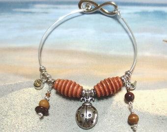 Infinity Bangle Bracelet/ Silver Ladybug Charm Bracelet/Brown Wooden Beads/Personalized Bracelet/Initial Charm/Birthstone Charm Jewelry