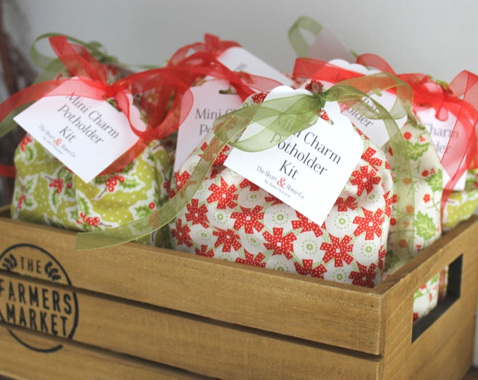 """Mini Charm Potholder Kit using Christmas Figs by Fig Tree & Co makes 2 potholders 8"""" x 10"""" Fabric Bags and fat quarters vary."""