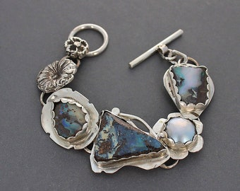 Three Opals with a Mabe Pearl