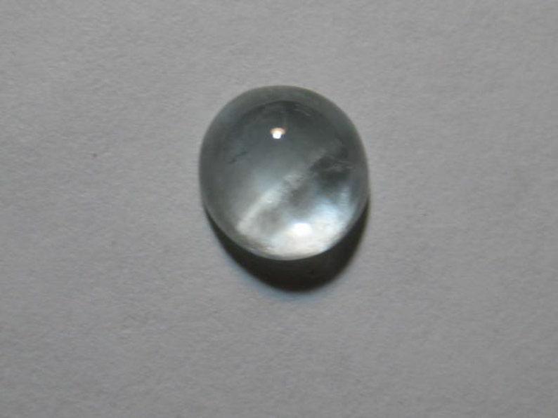 7.6 mm round x 7.6 mm tall   .............. B1992 Partial Cat/'s Eye Aquamarine  cab  ........