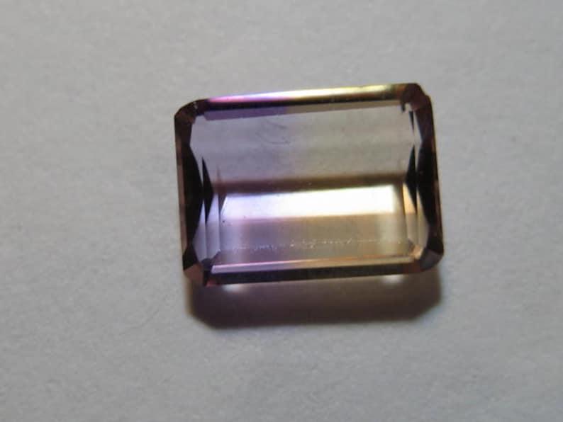 Ametrine faceted gemstone  ....................... B698 9.5 x 7 x 3.2 mm .....