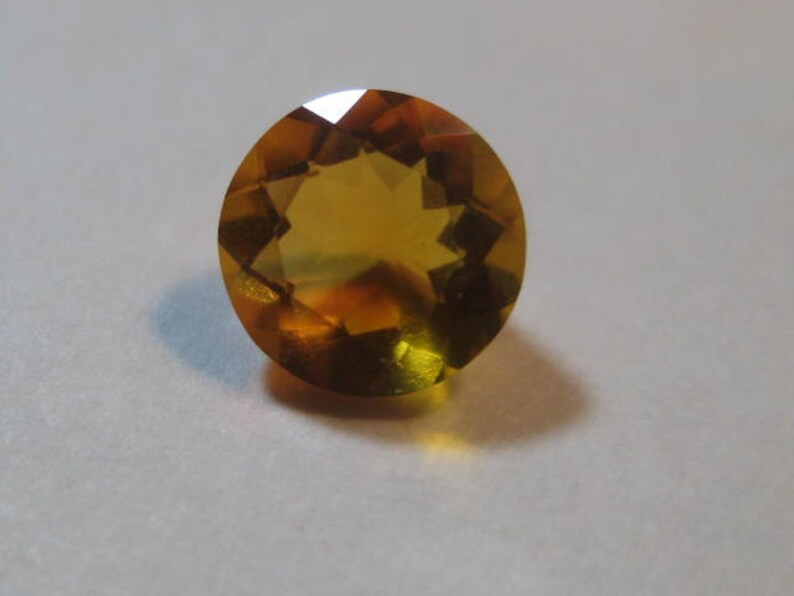 6.5 mm round x  4  mm . Natural   Mexican  Opal  ... faceted Round ... a3392