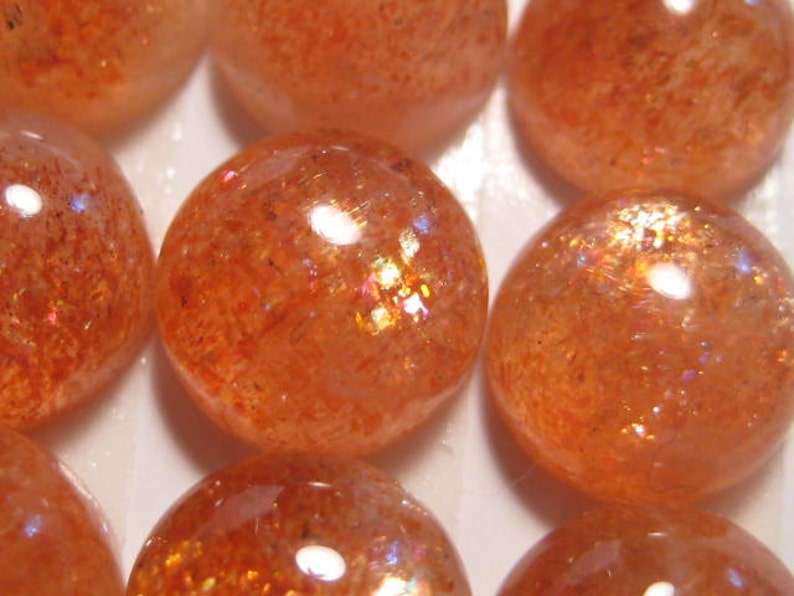 African  Sunstone cab........ 8 mm round  x 4 mm  tall ......... AAA grade   ... a4294 2 cabs  ..