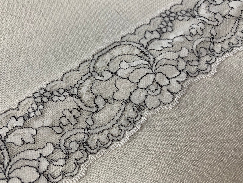 Domestic lace trim 2 14\u201d wide white and black scalloped trim light weight scalloped floral trim sold by the yard