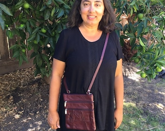 Leather burgundy burgandy crossbody purse bag 5 zippered pockets, fully adjustable strap