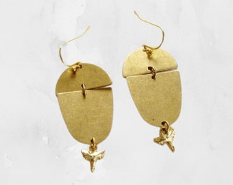 gold shark tooth earrings with brass geometric shape dangles