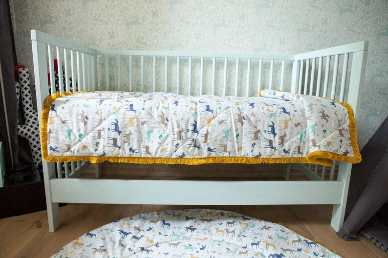 Couvre-lit bébé pour la literie de bébé couverture