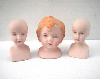 Three Small Painted Bisque Doll Heads