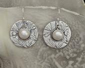 Pearl Saturn earrings...