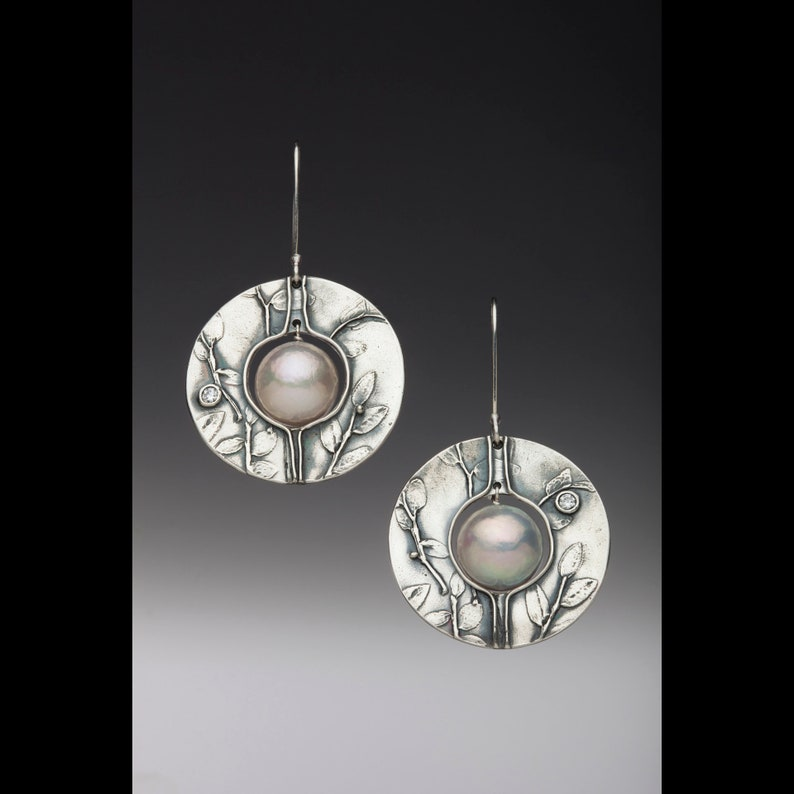 Pearl Saturn earrings image 0