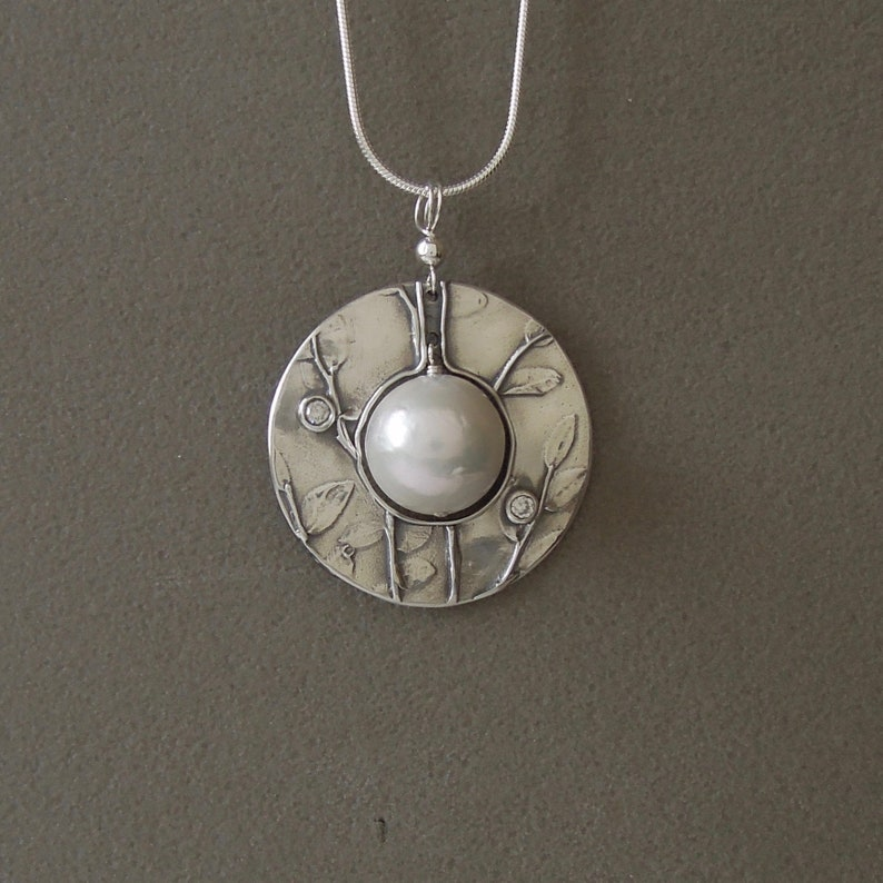Pearl Saturn necklace image 0