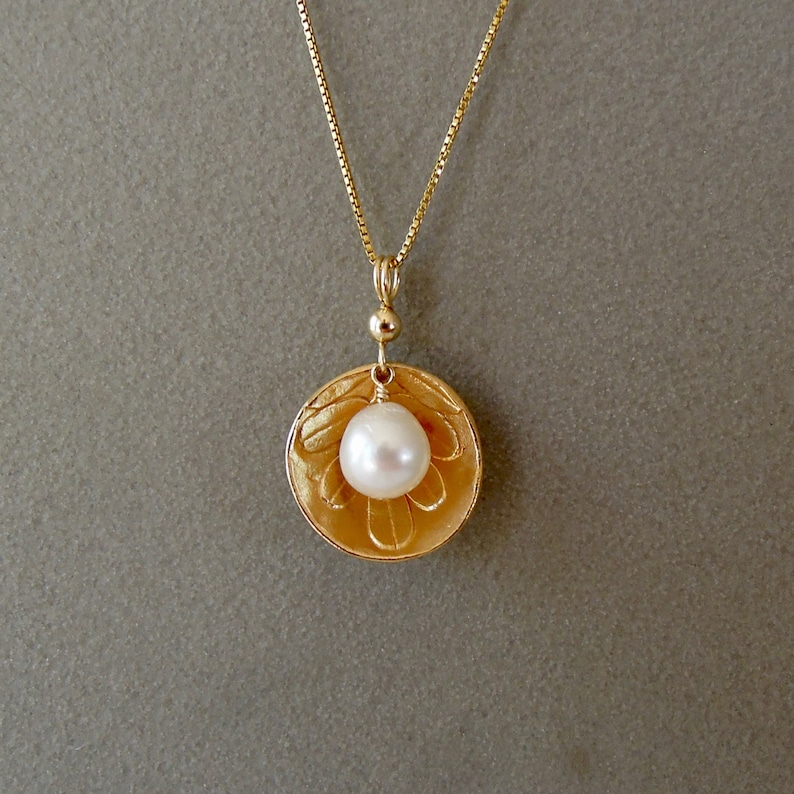 White pearl in golden bronze image 0