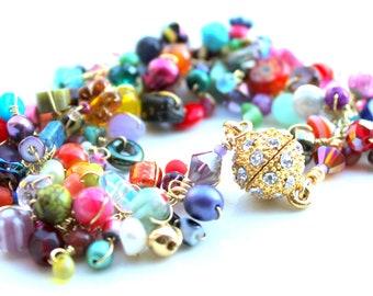 gold bling bracelet. multicolored uniquenecks wire wrapped bracelet. gemstones pearls swarovski polymer fruit. sparkle bracelet