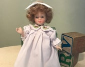 Small Porcelain Doll Curly Blonde Hair White Nightgown Bloomers Jointed Painted Face 6 inches 1990 39 s Vintage