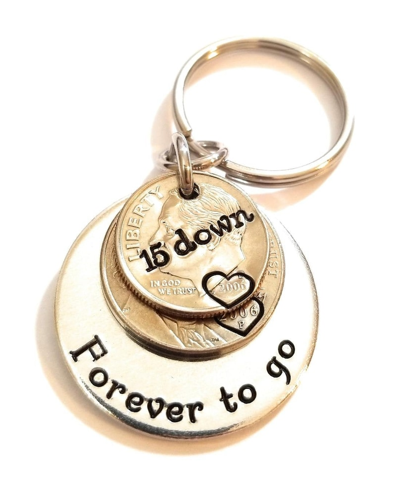 Getting many good reviews due to its beauty and durability, this dime and nickel key chain is a thoughtful 15th anniversary gift for your special person. Just leave your date or set of initials, your key chain will be perfectly stamped as your request.
