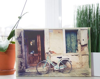 Picture of a Aquamarine colored Bicycle parked in front of a house in Burano Italy printed on Giclee Canvas mounted on Wood Frame.