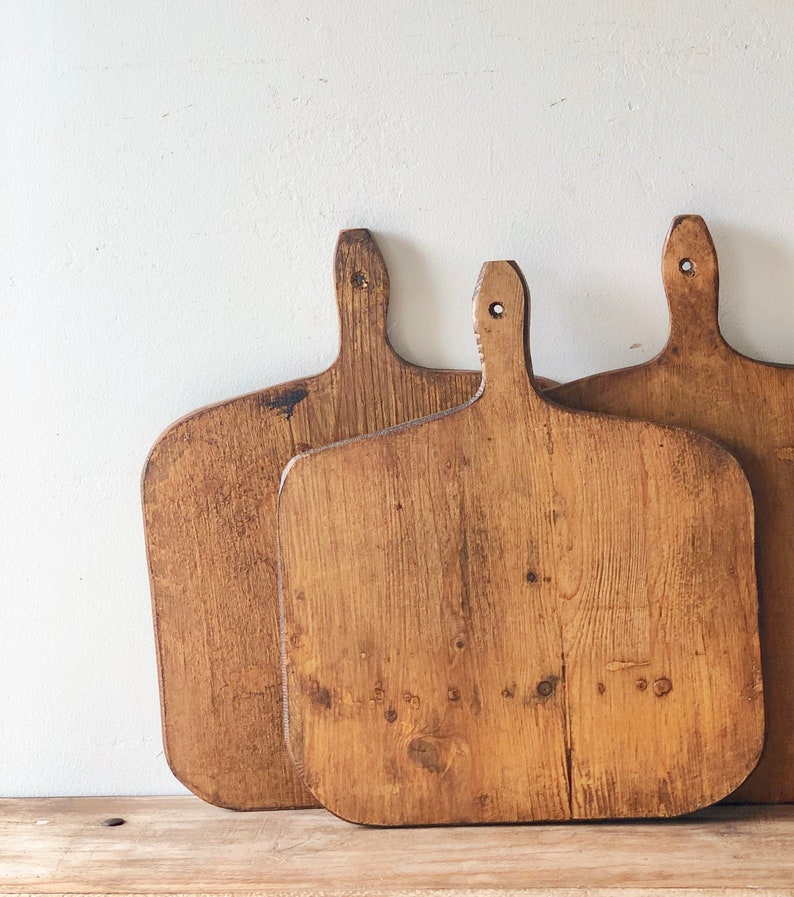 Lovely and rustic, these vintage French bread boards will add authentic character and decor to your French farmhouse, country French, or European country inspired space! Come discover more French Farmhouse Decor inspired by Fixer Upper and click here to Get the Look of The Club House Kitchen & Sun Room. #fixerupper #joannagaines #kitchendecor #frenchfarmhouse