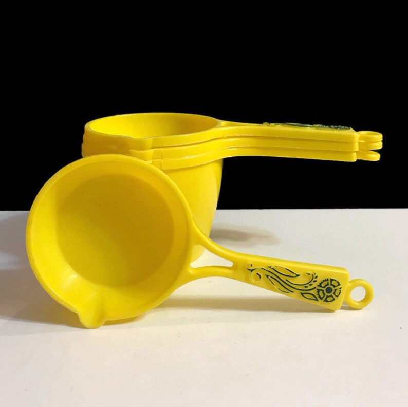 Vintage Yellow Plastic Stacked Measuring Cups with handles set of 4 Measuring Cups