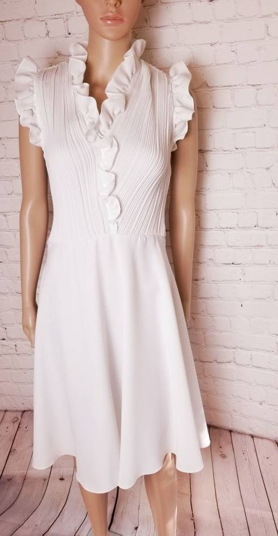 white disco skater dress with accordion pleats and