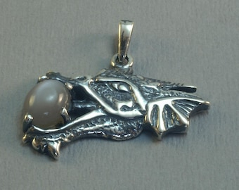 Sterling silver dragon head pendant with 7x9 cabochon stone