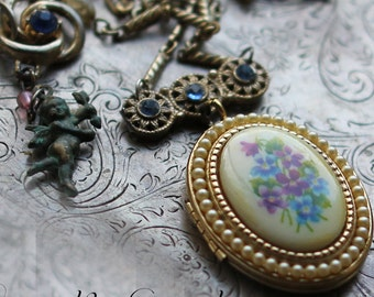 Forget Me Not ~ vintage assemblage locket necklace one of a kind blue rhinestones floral forget me nots violets angel crowned by grace